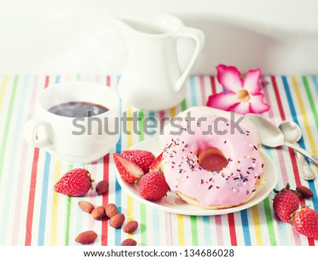 delicious strawberry doughnuts with coffee