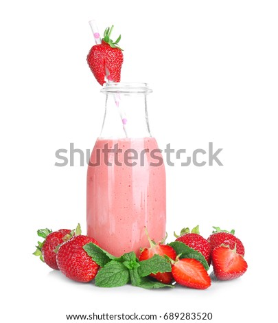 Delicious strawberry homemade smoothie in bottle on white background