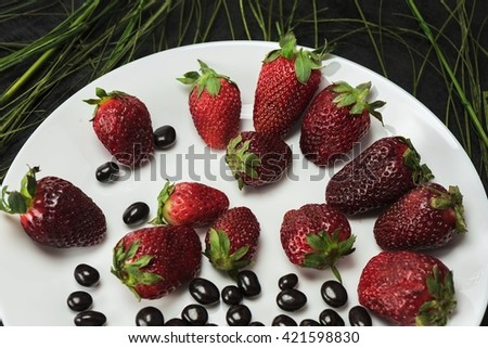 Delicious strawberry laid out on a white plate - stock photo