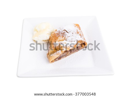 Delicious strudel with apple and walnuts. Served with scoop of vanilla ice cream. Isolated on a white background. - stock photo