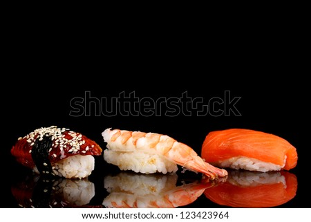 delicious sushi isolated on black - stock photo