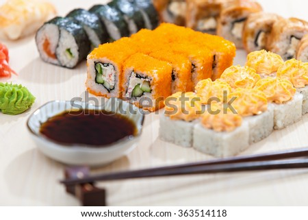 Delicious sushi rolls - stock photo