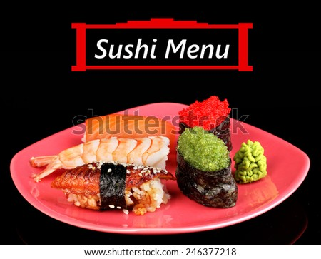 Delicious sushi served on plate isolated on black with space for your text - stock photo