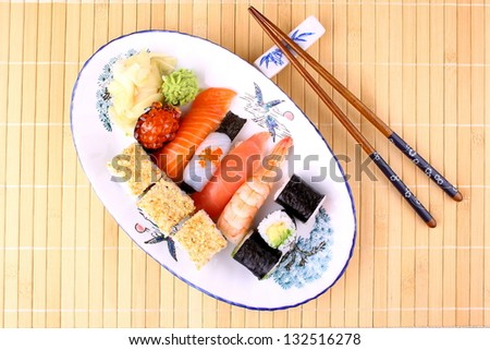 Delicious sushi with chopsticks and red caviar, top view - stock photo