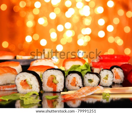 Delicious sushi with shiny blur background - stock photo