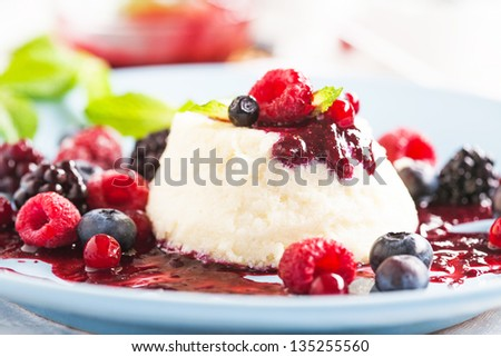 Delicious sweet berry dessert with fresh mint