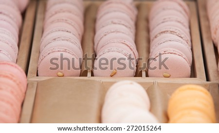 Delicious sweet buffet with colorful macarons in a  box. Shallow depth of field - stock photo