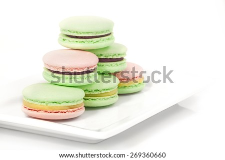 Delicious sweet buffet with macarons, isolated on white - stock photo