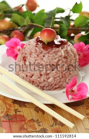 Delicious sweet dessert made of rice and cherries - stock photo