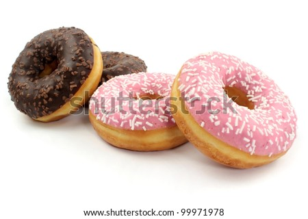 Delicious sweet donuts on white background. - stock photo