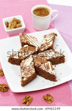 Delicious sweet walnut cocoa cake with afternoon coffee