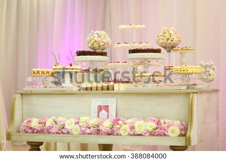 Delicious sweets on candy buffet - stock photo