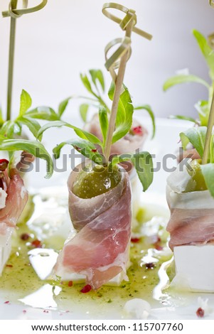 delicious tapas or finger food on sticks - stock photo