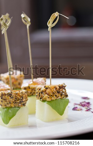 delicious tapas or finger food on sticks