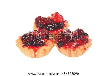 delicious tartlets with jam and berries on a white background