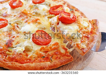 Delicious tasty pizza with cut slice, closeup