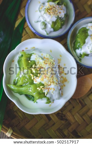 Delicious Thai Dessert, Coconut sweet pudding with coconut milk topping on Threshing Basket