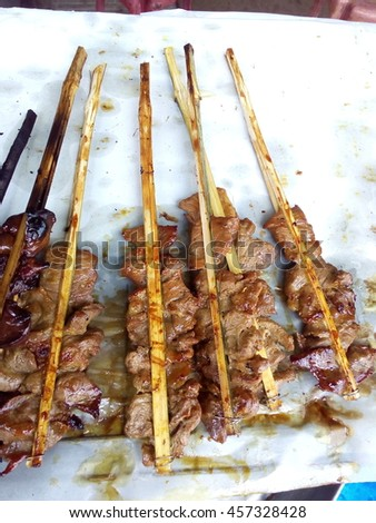 delicious Thai street foods, grilled chicken grilled pork, grilled chicken liver,grilled pork  sausage etc. - stock photo