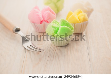 Delicious Thai sweet dessert on wood  - stock photo