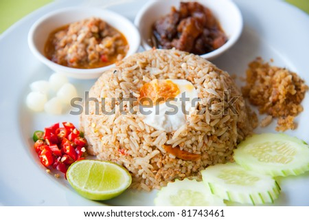 Delicious Thailand traditional food : fried rice with chili dip, pork and salt egg - stock photo