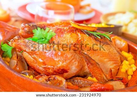 Delicious Thanksgiving turkey on festive table, traditional prepared poultry for American autumn holiday, family dinner at home - stock photo