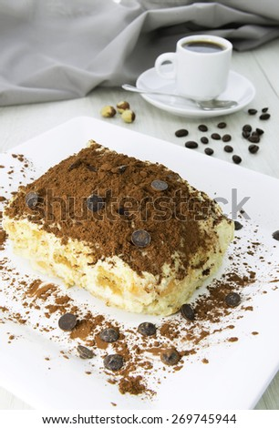 Delicious tiramisu dessert with cacao powder on top - stock photo