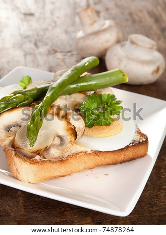 Delicious toast bread with eggs mushrooms and asparagus - stock photo