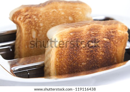 Delicious toasted bread on a white background - stock photo