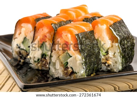 delicious traditional Japanese food - rolls with salmon - stock photo