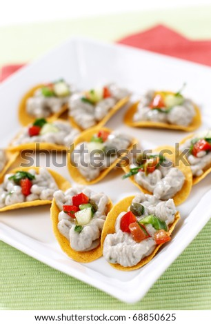 Delicious tuna pate on tortilla canape - stock photo