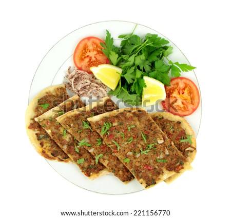 Delicious Turkish Pizza. ( Lahmacun or Etli ekmek ) isolated on white background. - stock photo