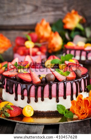 Delicious two-ply strawberry cheesecake (cake) decorated with chocolate and fresh berries - stock photo
