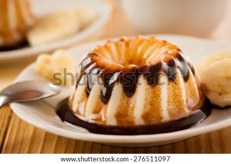 Delicious vanilla pudding with chocolate syrup