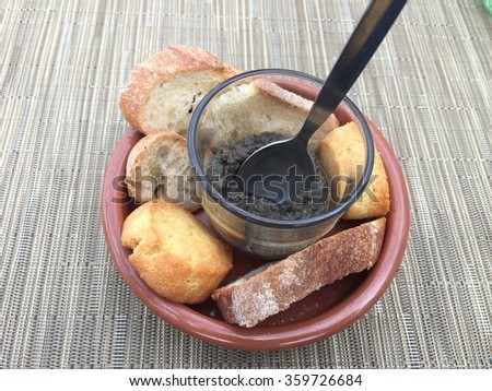 Delicious variety Breads with mix vegetable dip in bowl on wood table - stock photo