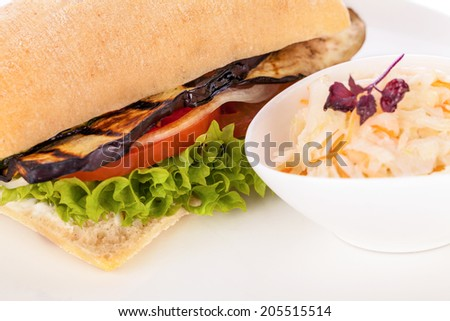 delicious vegan burger with ciabatta bread grilled eggplant and salad - stock photo