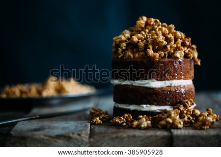 Delicious vegan super caramel cake with pop corn on beautiful wooden stands in vintage interior - stock photo