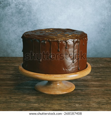 Delicious vegan super chocolate cake on beautiful wooden stands in vintage interior - stock photo