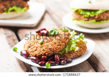 Delicious vegetable bean burgers with herbs and garnish