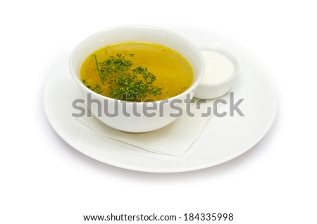 delicious vegetable soup with greens isolated on white background