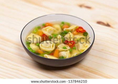 Delicious Vegetable Soup with Tortellini - stock photo