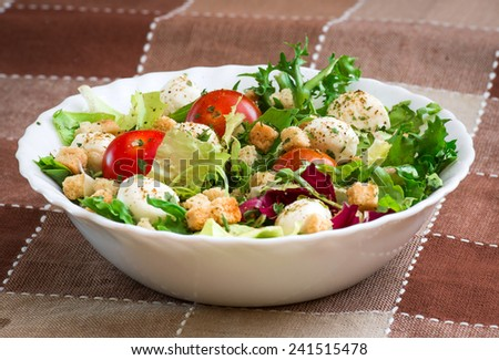 delicious vegetarian salad in the white plate - stock photo
