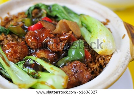 Delicious vegetarian sweet and sour pork cuisine. Ingredients include deep fried mock meat and healthy greens. Suitable for food and beverage, healthy lifestyle, and creative food. - stock photo