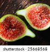 Delicious vibrant honey sweet green fig. Figs halved - stock photo