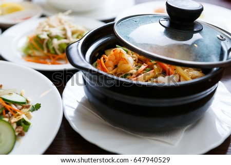 Delicious Vietnamese seafood dish in bowl.Shrimps with fresh vegetables & rice.Traditional Asian cuisine in restaurant.Natural gourmet menu in cafe.Good diet with healthy ingredients.Food from Vietnam