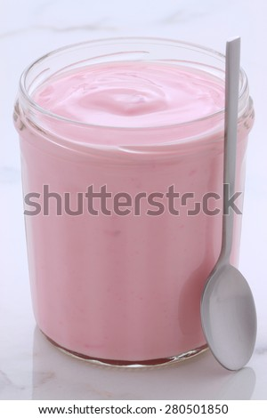Delicious vintage custard-style yogurt with all the fruit mixed inside during the process. On Italian carrara marble retro styling. - stock photo