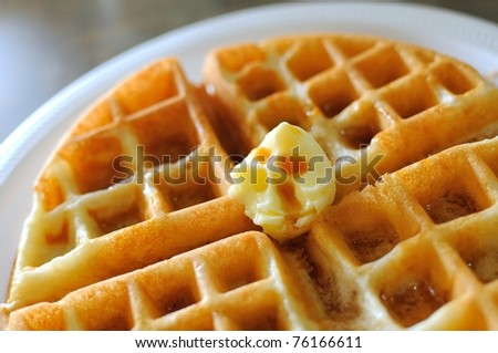 Delicious waffle pancake with butter and honey for breakfast. - stock photo