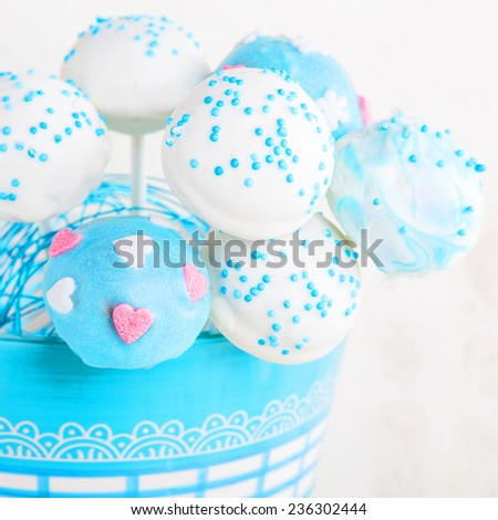 Delicious wedding cake pops in white and soft blue - stock photo