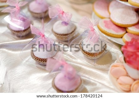 Delicious wedding cupcakes in pink and purple - stock photo