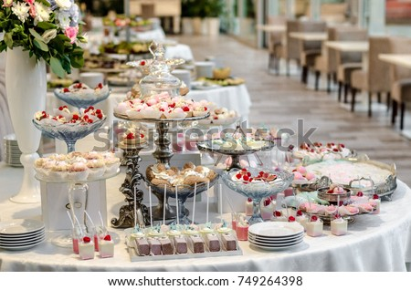Delicious Wedding Reception Candy Bar Dessert Table Full With Cakes And Sweets A Flower Vase