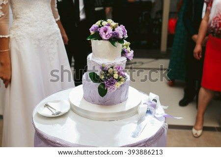 Delicious white wedding cake purple flowers stock photo royalty delicious white wedding cake with purple flowers at reception mightylinksfo